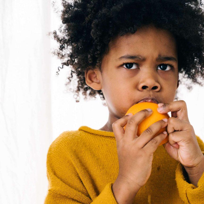 kid eating fruit